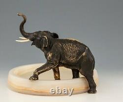 Antique Viennese Bronze Elephant business card holder on white onyx mount